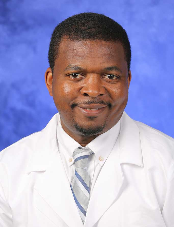 A professional head-and-shoulders photo of Dr. Alain Lekoubou