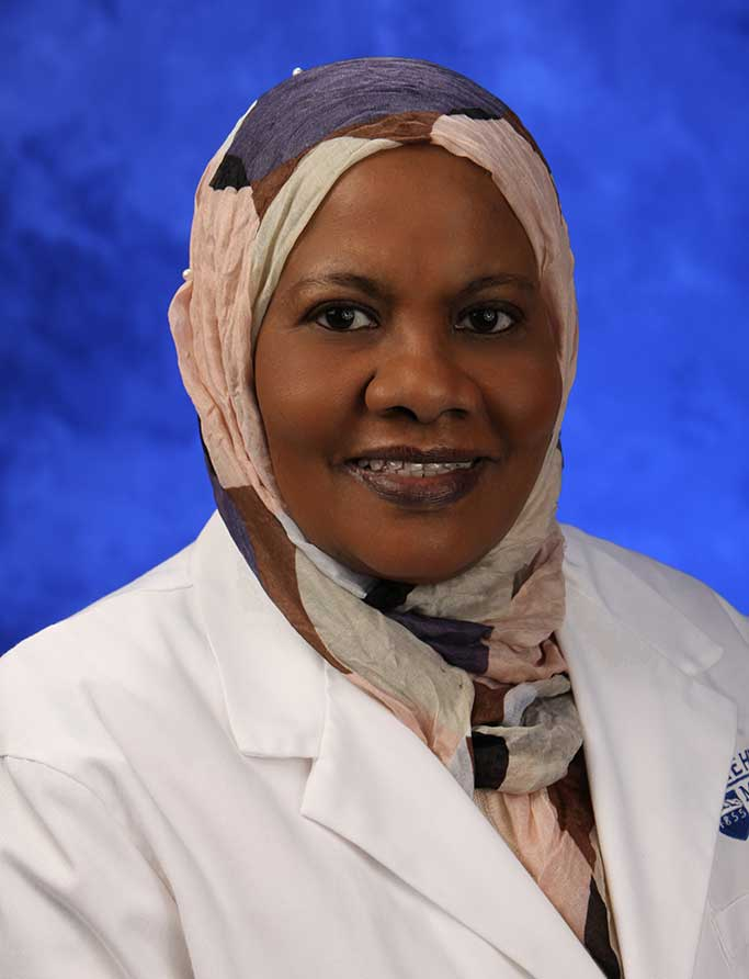 A head-and-shoulders professional photo of Alawia Suliman