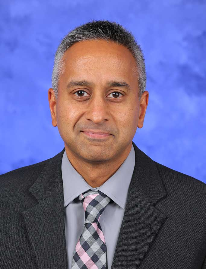 A head-and-shoulders photo of Jay D. Raman, MD