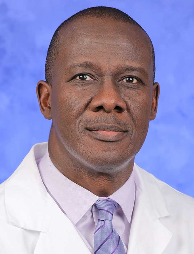 A head-and-shoulders professional photo of Dr. Kofi Clarke