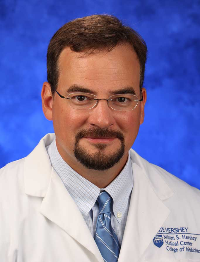 A head-and-shoulders professional photo of Dr. Matthew Coates