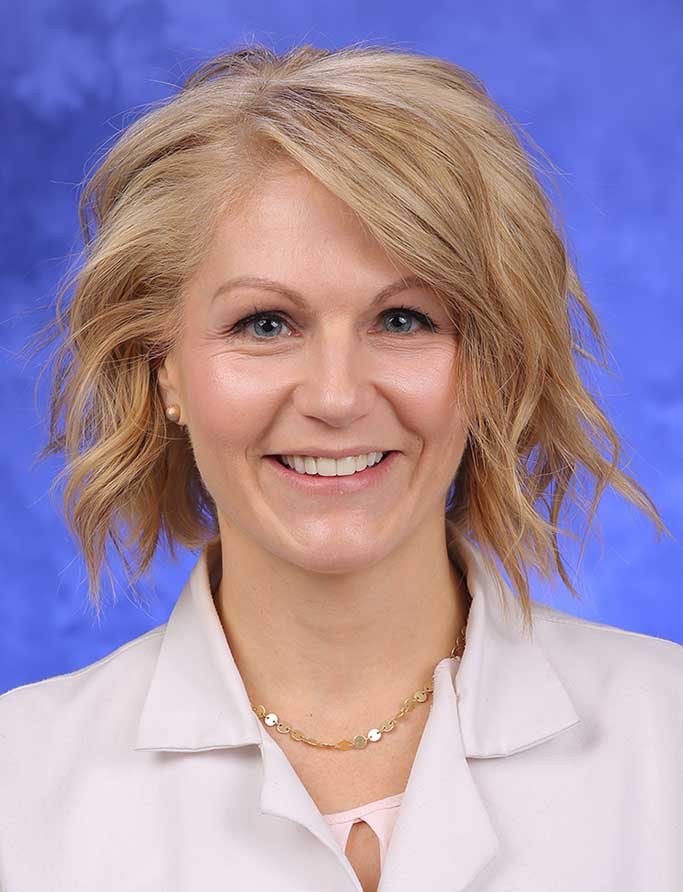 A head-and-shoulders professional photo of Nicole Osevala, MD, FACP